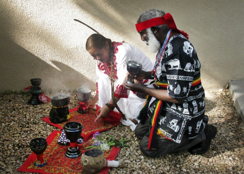 FILE - This July 22, 2013 file photo shows curanderos, or traditional healers, conducting a ceremony on the campus of the University of New Mexico in Albuquerque. The University of New Mexico is going to offer a free online class on curanderismo, the art of traditional healing. The school announced