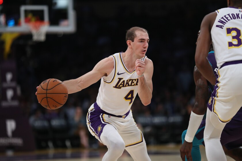 Lakers guard Alex Caruso drives to the basket during a win over the Charlotte Hornets on Sunday.