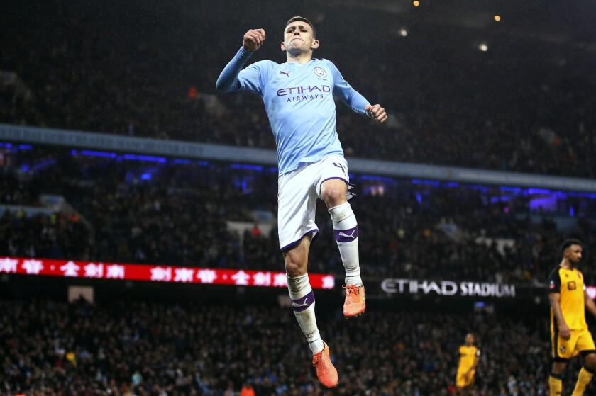 Manchester City's Phil Foden celebrates scoring his side's fourth goal of the game during the English FA Cup third round soccer match between Manchester City and Port Vale at the Etihad Stadium, Manchester, England, Saturday, Jan. 4, 2020. (Martin Rickett/PA via AP)
