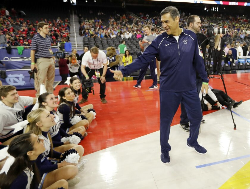 Villanova head coach Jay Wright gives a thumbs up to some cheerleaders during a practice session for the NCAA Final Four college basketball tournament Friday, April 1, 2016, in Houston. (AP Photo/David J. Phillip)