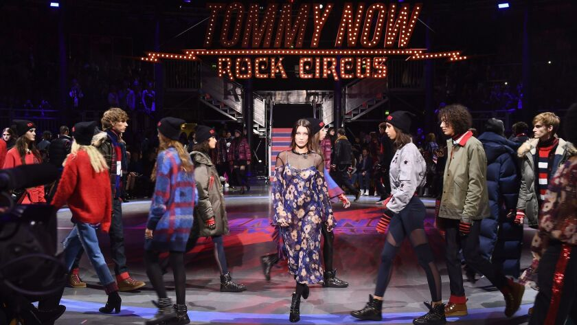 Bella Hadid, center, and other models walk the runway at Tommy Hilfiger and Gigi Hadid's TommyNow fall and winter 2017 show during London Fashion Week at the Roundhouse in London on Sept. 19.