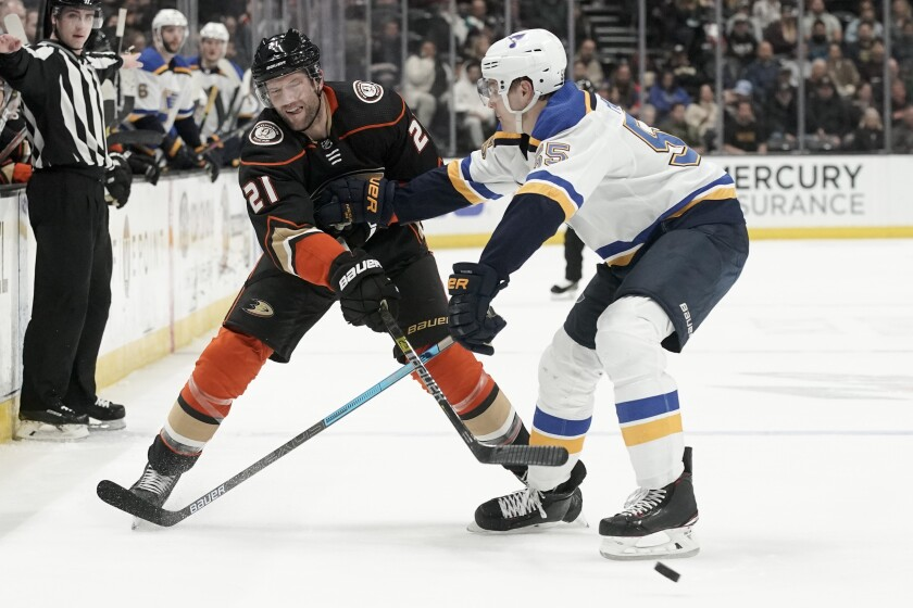 Ducks right wing David Backes, left, passes around St. Louis Blues defenseman Colton Parayko during the second period on Wednesday at Honda Center.