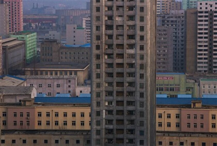 FILE - In this Wednesday, April 10, 2013, an apartment block stands among the buildings in central Pyongyang, North Korea at dusk. (AP Photo/David Guttenfelder, File)