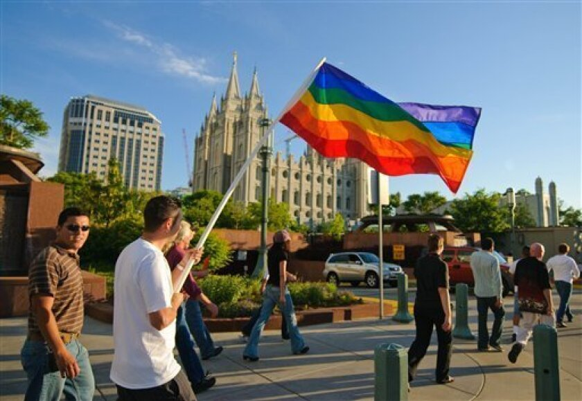 In this Nov. 7, 2008 publicity image released by Red Flag Releasing, people gather to protest at Mormon headquarters and their support of California's 2008 Proposition 8, a ballot initiative banning gay marriage, in Salt Lake City.  The Mormon position on gay marriage is the focus of the documentar