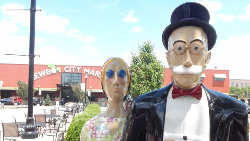 "If you have played Monopoly, you probably recognize Rich Uncle Pennybags, and his companion may look vaguely familiar. They are just one of 25 ""American Gothic"" fiberglass couple statues painted by local artists in Cedar Rapids, Iowa."