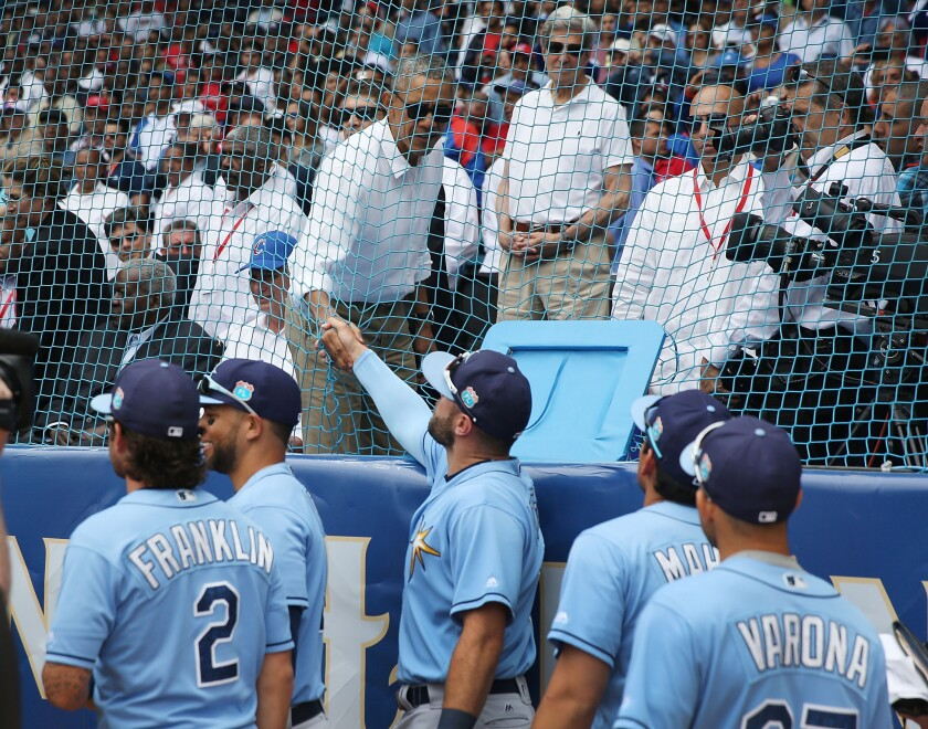President Obama shakes hands with Tampa Bay Rays players before an exhibition game against the Cuban national team in Havana on Tuesday.