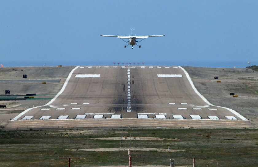 A plane lands at McClellan-Palomar Airport in Carlsbad, where San Diego County supervisors have approved an updated 20-year master plan.