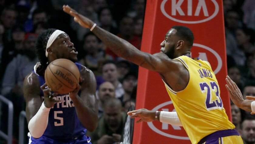 Lakers' LeBron James defends against Clippers' Montrezl Harrell in the second quarter.