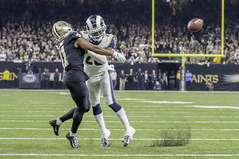 Rams cornerback Nickell Robey-Coleman makes contact with Saints wide receiver TommyLee Lewis.