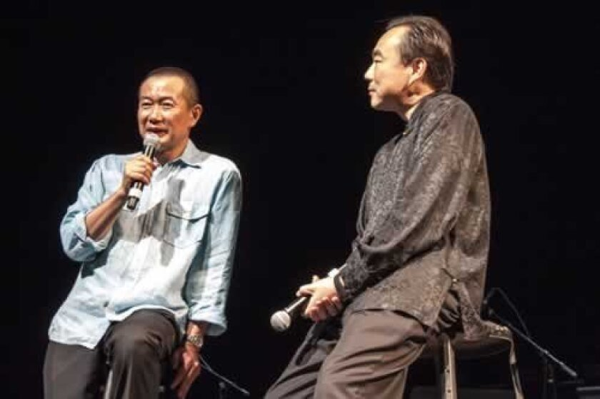 Composer/conductor Tan Dun, in a pre-concert chat with violinist/Summerfest music director Cho-Liang 'Jimmy' Lin.