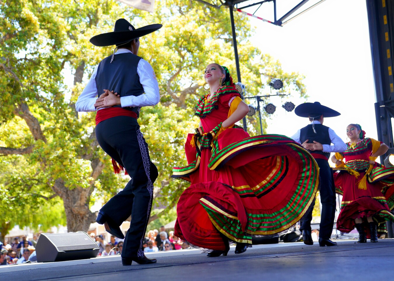"Folklorico dancers from the group ""Tradition Mexicana USA"" competed on stage in the Folklorico Festival during the Cinco de Mayo celebration on Sunday at Old Town."