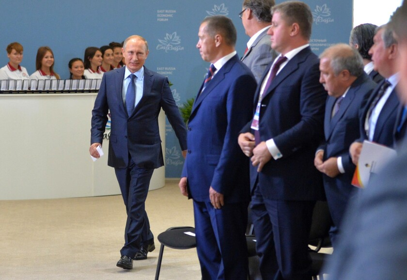Russian President Vladimir Putin, left, arrives at the opening of the East Economic Forum in Vladivostok on Sept. 4, where he pressed his diplomatic initiative to end Syria's civil war.