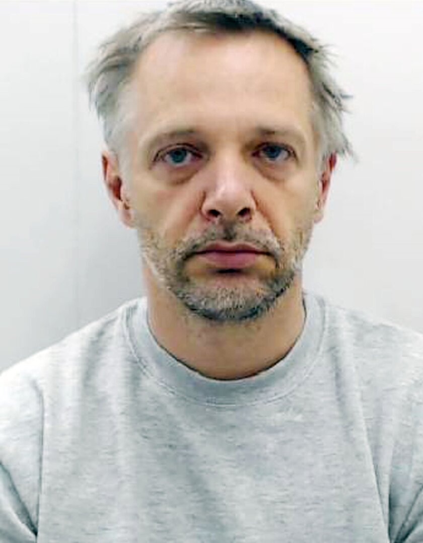 """Undated photo issued Monday March 21, 2016, by Greater Manchester Police, showing 48-year old John Martin, who has been sentenced Monday March 21, 2016, to more than 17-years in prison for beating and strangling his concert pianist wife Natalia Strelchenko to death. Martin claims he has no recollection of the killing, but was convicted of murdering 38-year-old Strelchenko, in a """"prolonged and ferocious attack,"""" at the couple's home in Manchester, England. (Greater Manchester Police via AP)"""