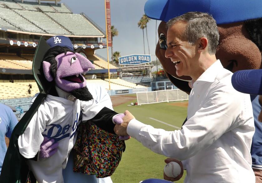 Mayor Eric Garcetti with Count von Count.