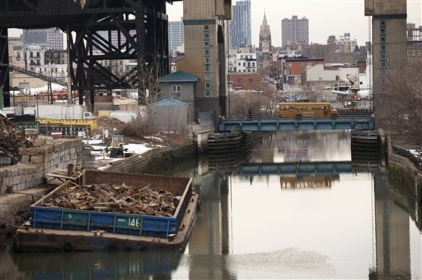FILE - This file photo of March 2, 2010 shows the Gowanus Canal, which was added to the Superfund National Priorities List in 2010 for being heavily contaminated with PCBs, heavy metals, volatile organics and coal tar wastes. New York, New Jersey and EPA officials say toxic sites are OK after Super
