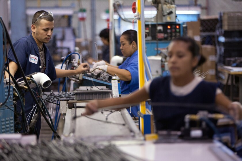 Workers at a foreign-owned border factory, or maquiladora, in Juarez.