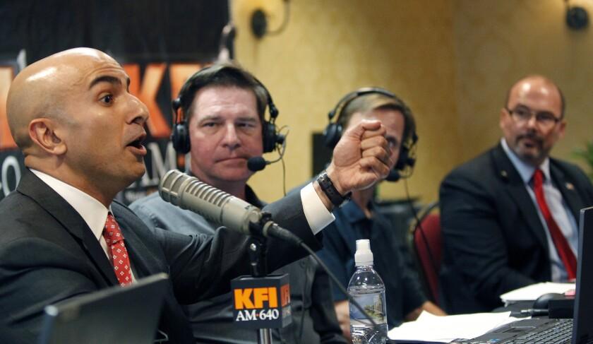 California Republican gubernatorial candidates Neel Kashkari, left, and Tim Donnelly, far right, at an Anaheim debate last week.