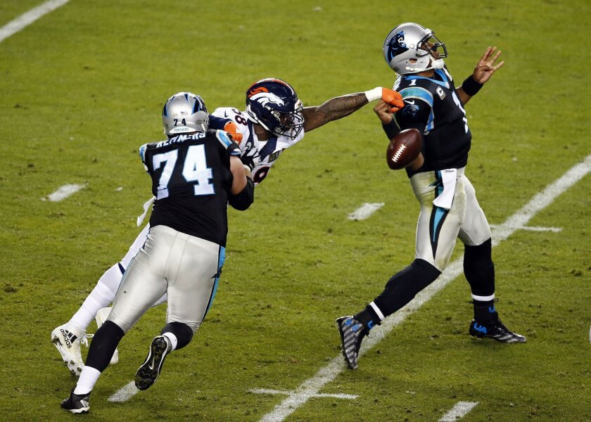 Denver Broncos linebacker Von Miller forces a fumble by Carolina Panthers quarterback Cam Newton in the fourth quarter of Super Bowl 50.