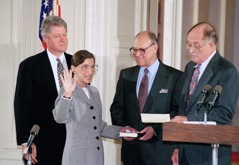 Supreme Court Justice Ruth Bader Ginsburg takes the court oath from Chief Justice William Rehnquist, right, in 1993.