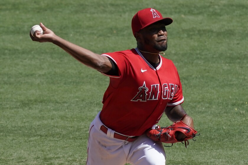 Angels starting pitcher Julio Teheran pitches against the Texas Rangers during Sunday's 7-2 loss.