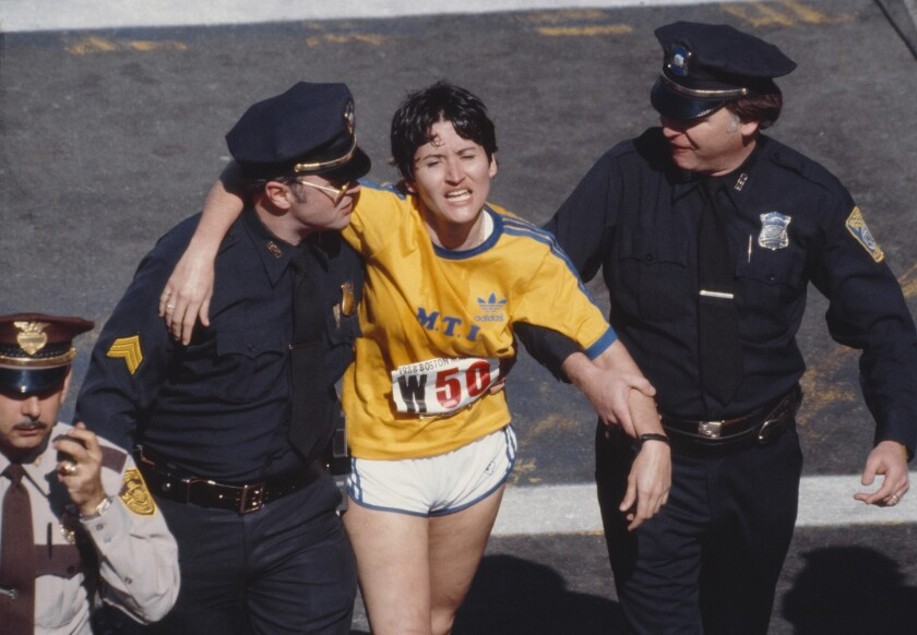 Rosie Ruiz is shown moments after crossing the finish line as the apparent women's race winner of the 84th Boston Marathon on April 21, 1980.