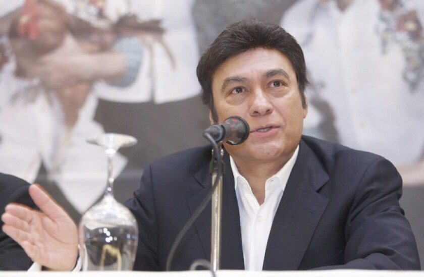 """Jorge Hernandez, leader of the Los Tigres del Norte band, speaks during a news conference in Mexico City. Of their music he says, """"We always sing what the people want to hear, and what the people are living."""""""