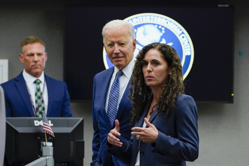 President Joe Biden listens as Director of the National Counterterrorism Center Christine Abizaid speaks during a visit to the Office of the Director of National Intelligence in McLean, Va., Tuesday, July 27, 2021. This is Biden's first visit to an agency of the U.S. intelligence community. (AP Photo/Susan Walsh)