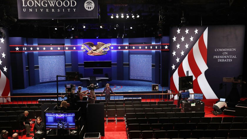 Final preparations are made on the set for the vice presidential debate at Longwood University in Farmville, Va.
