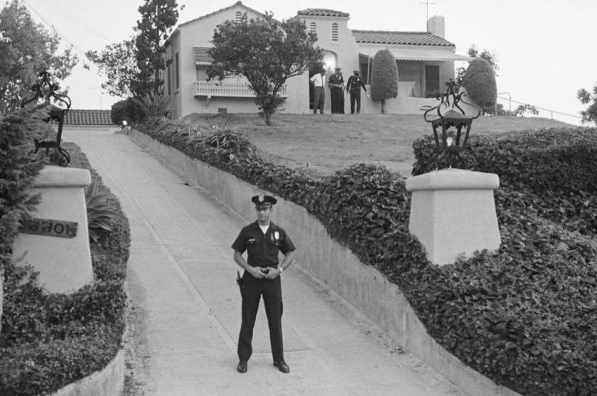 A Los Angeles police officer outside the Los Feliz house in 1969 after Manson murders.