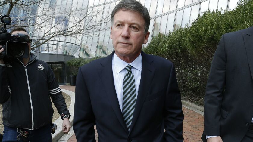 Bruce Isackson departs federal court in Boston on April 3 after facing charges in a nationwide college admissions bribery scandal.
