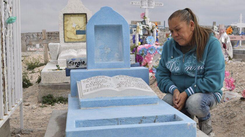 Maria Guadalupe Guereca, 60, visits the grave of son Sergio Hernandez at the Jardines del Recuerdo cemetery in Ciudad Juarez, Mexico.