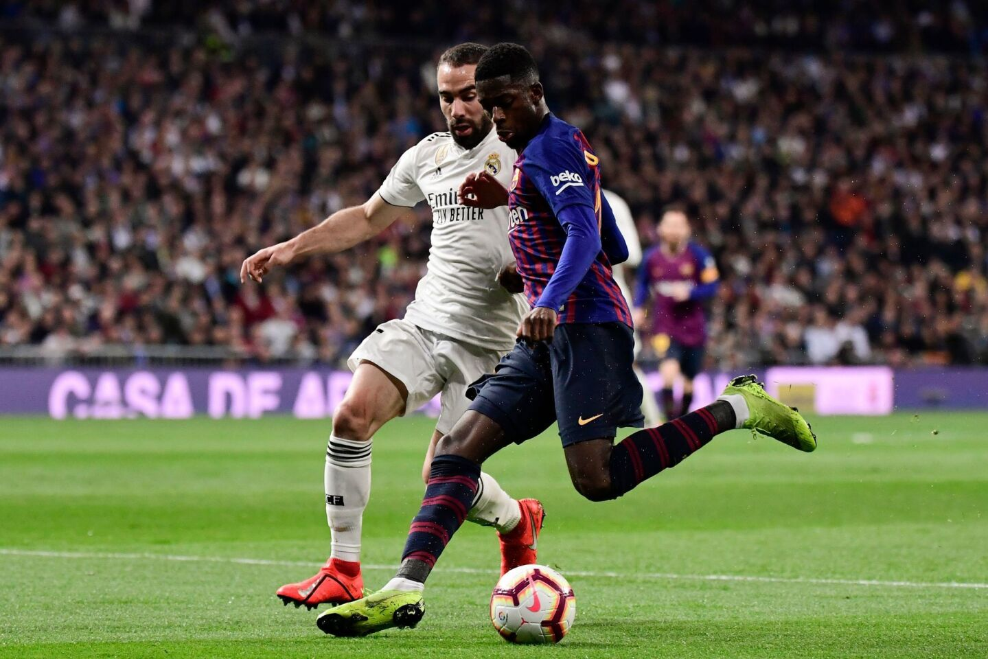 Barcelona's French forward Ousmane Dembele (R) challenges Real Madrid's Spanish defender Dani Carvajal during the Spanish league football match between Real Madrid CF and FC Barcelona at the Santiago Bernabeu stadium in Madrid on March 2, 2019. (Photo by JAVIER SORIANO / AFP)JAVIER SORIANO/AFP/Getty Images ** OUTS - ELSENT, FPG, CM - OUTS * NM, PH, VA if sourced by CT, LA or MoD **
