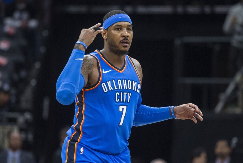 Carmelo Anthony celebrates a three-pointer during a game.