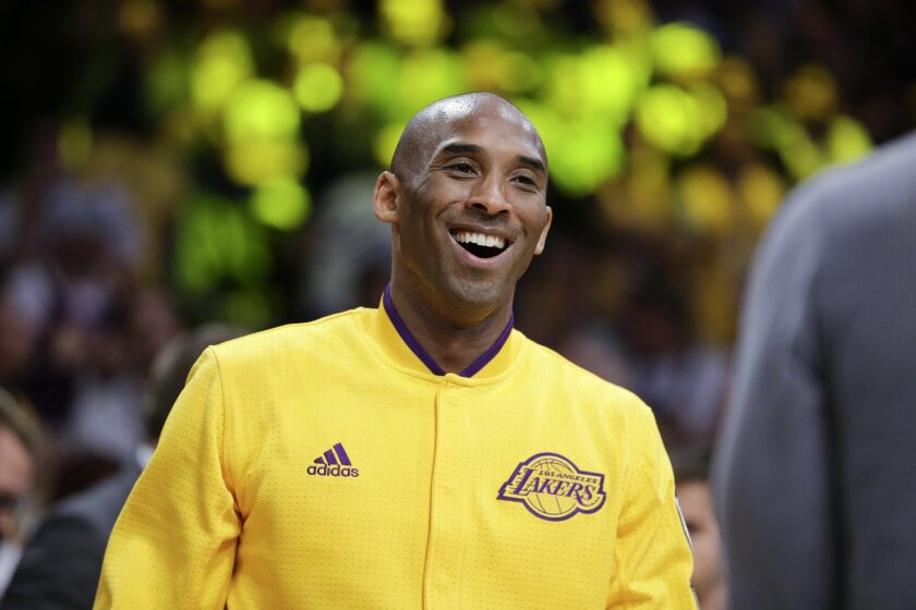Los Angeles Lakers forward Kobe Bryant smiles to the crowd during a ceremony before Bryant's last NBA basketball game, against the Utah Jazz, Wednesday, April 13, 2016, in Los Angeles. (AP Photo/Jae C. Hong)