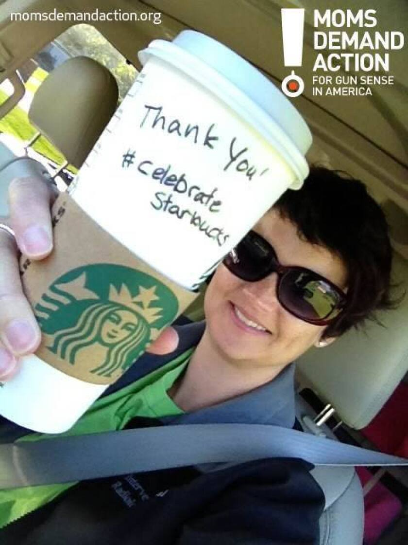 A Maryland member of Moms Demand Action for Gun Sense in America shows her support for Starbucks' new policy change.