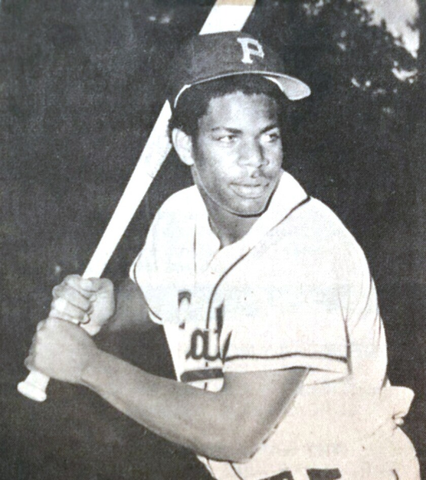 Rod Ingram, wearing a baseball jersey and cap, holds a bat in a hitting stance.