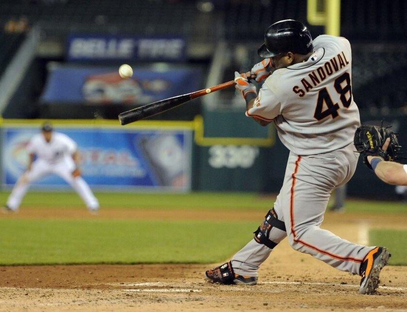 San Francisco Giants' Pablo Sandoval hits a home run against the Detroit Tigers in the sixth inning of a baseball game Friday, Sept. 5, 2014, in Detroit. (AP Photo/Jose Juarez)