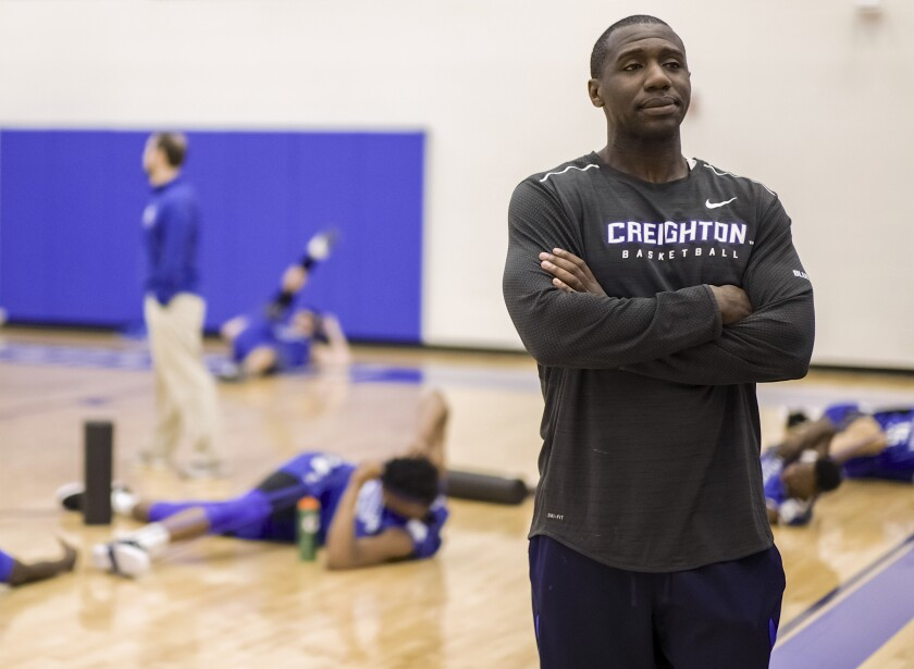 FILE - In this March 17, 2017, file photo, Creighton assistant coach Preston Murphy, right, stands as players warm up during practice in Omaha, Neb. The NCAA put Creighton men's basketball program on two years' probation and docked scholarships each of the next two seasons on Tuesday, June 22, 2021, after alleging that a former assistant coach accepted cash from a management agency. The committee on infractions said Preston Murphy did not take any other action after the meeting in a Las Vegas hotel. But the meeting itself violated NCAA rules because the receipt of money formalized a business relationship in which the management company could attempt to use the coach to gain access to Creighton players. (AP Photo/Nati Harnik, File)