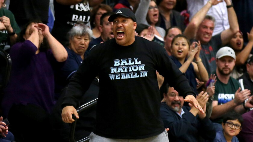 LaVar Ball cheers during a game last year when all three of his sons played together at Chino Hills High School.