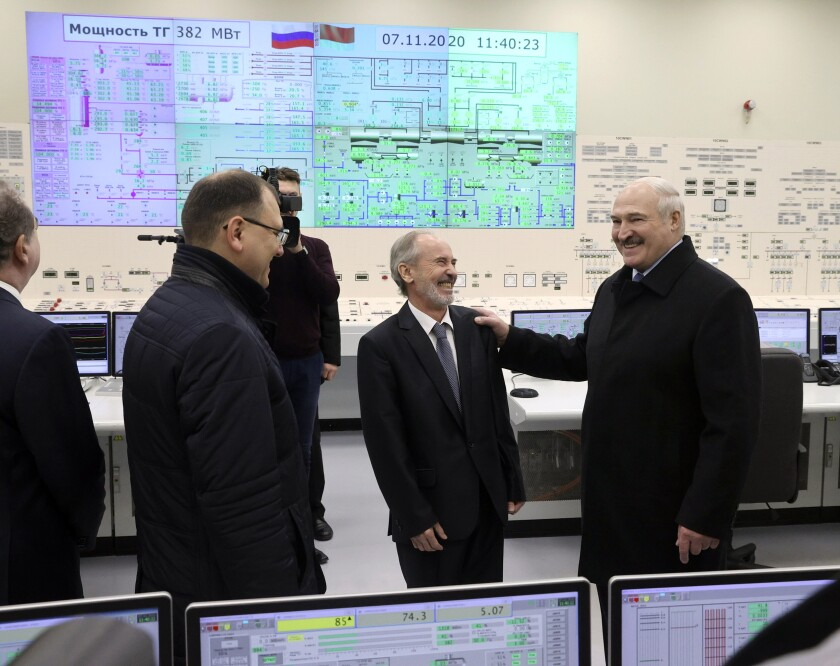 "Belarusian President Alexander Lukashenko, right, attends the first Belarusian Nuclear Power Plant during the plant's power launch event outside the city of Astravets, Belarus, Saturday, Nov. 7, 2020. Alexander Lukashenko on Saturday formally opened the country's first nuclear power plant, a project sharply criticized by neighboring Lithuania. Lukashenko said the launch of the Russian-built and -financed Astravyets plant ""will serve as an impetus for attracting the most advanced technologies to the country. and innovative directions in science and education."" (Nikolai Petrov/BelTA Pool Photo via AP)"