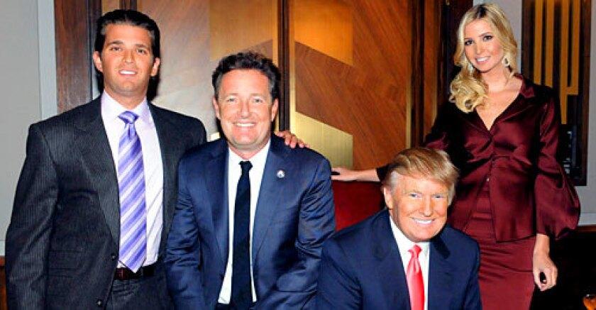 "HIGH PRAISE: ""Apprentice"" host Donald Trump said Morgan ""did an amazing job"" and showed up his celebrity competitors. Donald Trump Jr., left, poses with Piers Morgan, Donald Trump, and Ivanka Trump during the finale of ""The Celebrity Apprentice."""