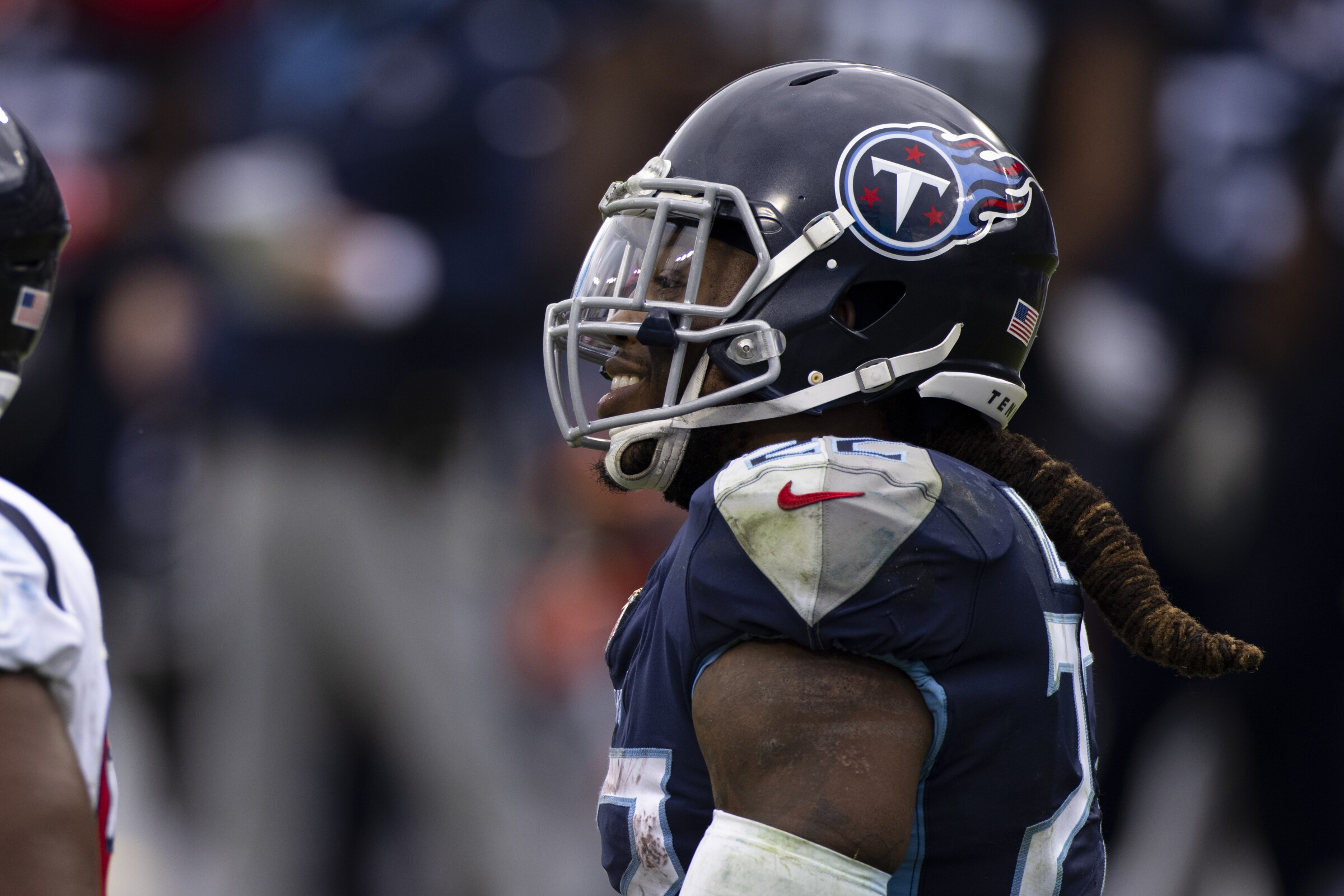 Tennessee Titans running back Derrick Henry smiles after a run.