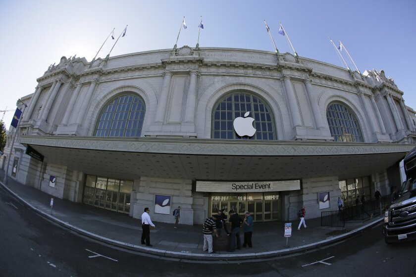 A crew works outside the Bill Graham Civic Auditorium as preparations continue for the Apple product announcements in San Francisco.