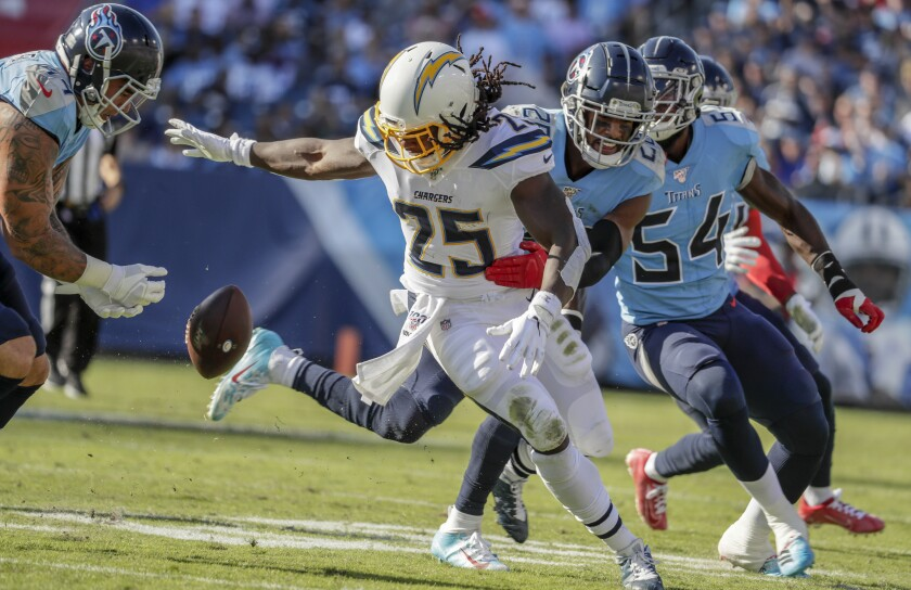 Chargers running back Melvin Gordon fumbles the ball.