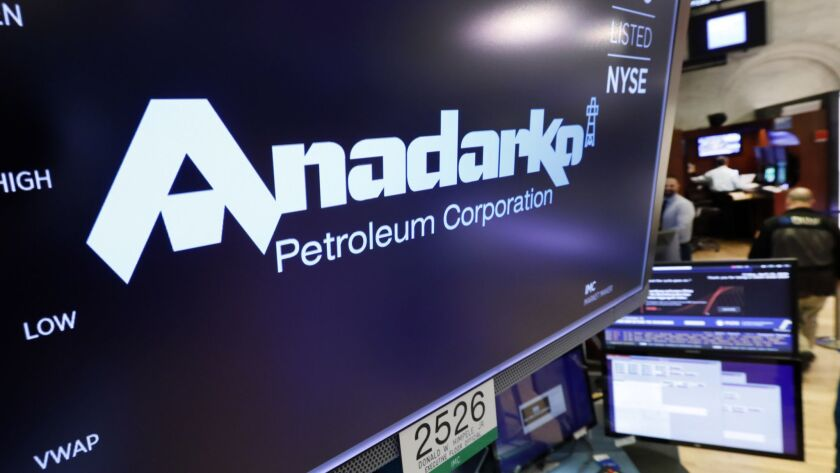 FILE - In this April 12, 2019, file photo the logo for Anadarko Petroleum Corp. appears above a trad