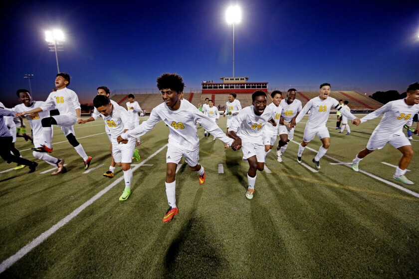 Soccer players from Margaret Long Wisdom High School in Houston celebrate an undefeated season.