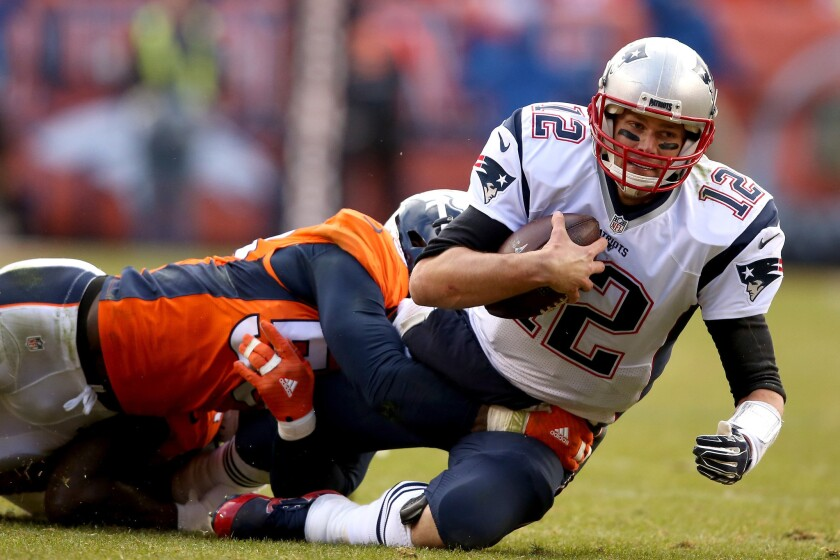 New England quarterback Tom Brady is sacked by Denver linebacker Von MIller during the second quarter of the AFC championship game on Jan. 24, 2016.