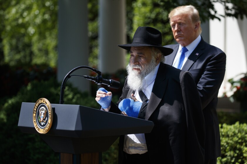 President Donald Trump looks on as Rabbi Yisroel Goldstein speaks during a National Day of Prayer event in the Rose Garden of the White House, Thursday, May 2, 2019.