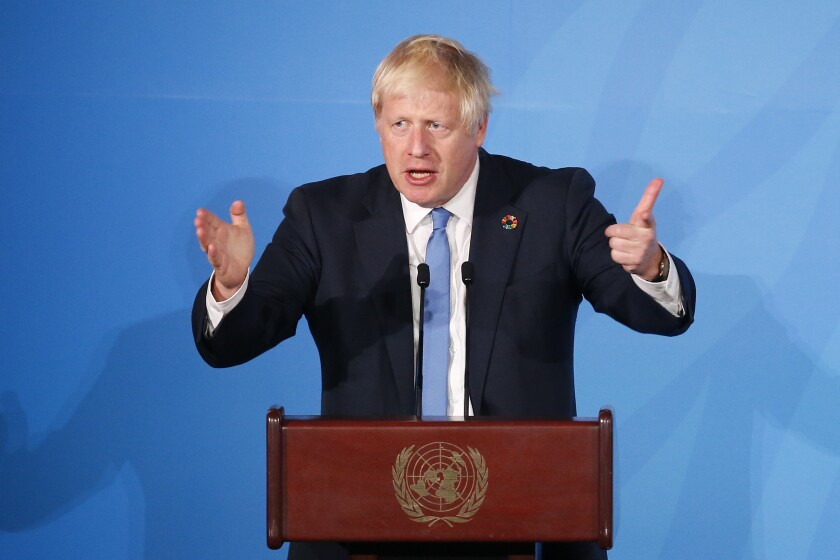Britain's Prime Minister Boris Johnson addresses the Climate Action Summit in the United Nations General Assembly at the U.N. headquarters, Monday, Sept. 23, 2019. (