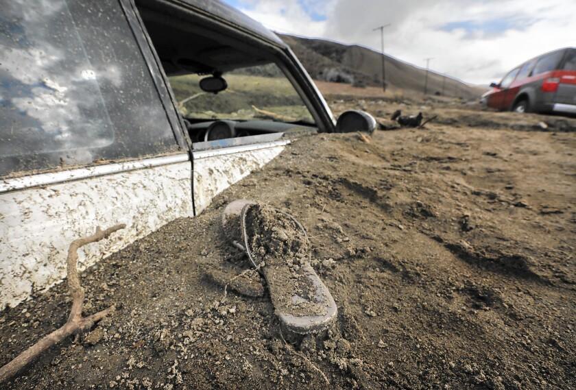 A sandal is left behind where a Mini Cooper was buried in a mudslide in Elizabeth Lake.